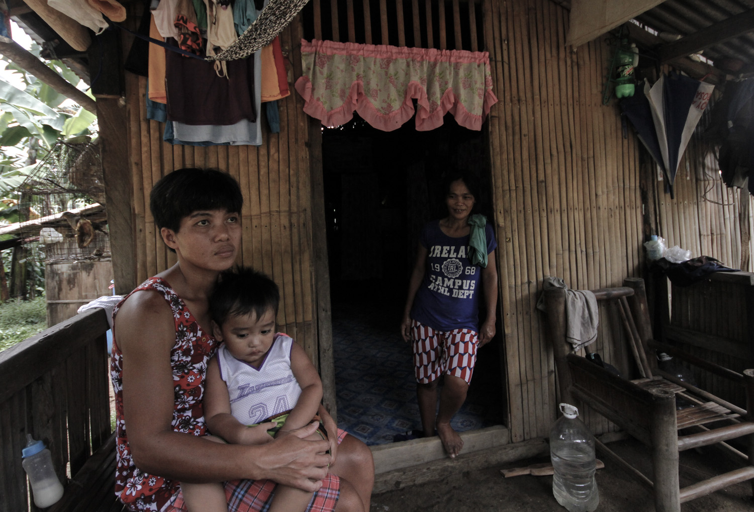 Leonora Andaleon looks at the light bulb in her house at Sitio Dalid, Magallanes, Cavite. Andaleon, 72, could not believe electricity would ever reach her remote village.