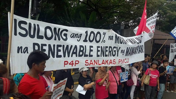 Power for People Coalition holds a mobilization in front of the House Of Representatives to demand our lawmakers to push for clean, affordable, renewable energy for all. photo credit: CEED