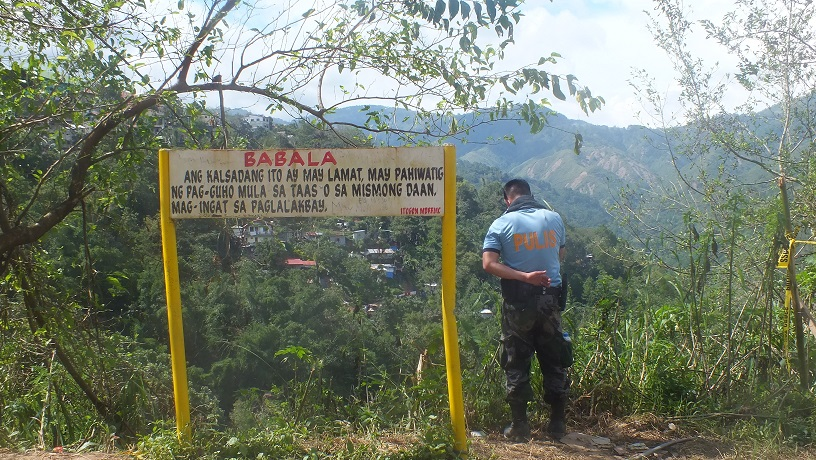 Danger zone warnings have been installed since the mines and geo-sciences bureau identified the spot as a geo-hazard area. Photo by Maria Elena Catajan.