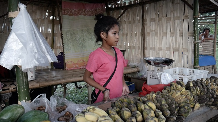 An Aeta girl tends to her store in the Aeta Village, a bazaar of Aeta products inside Subic. The bazaar is part of the local government's efforts to promote the Aeta culture. Photo by Terence Gonzalves.