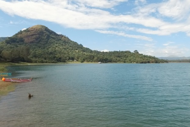 The_stillness_of_Mapanuepe_Lake_is_belies_the_tragedy_that_it_is_borne_out_of.