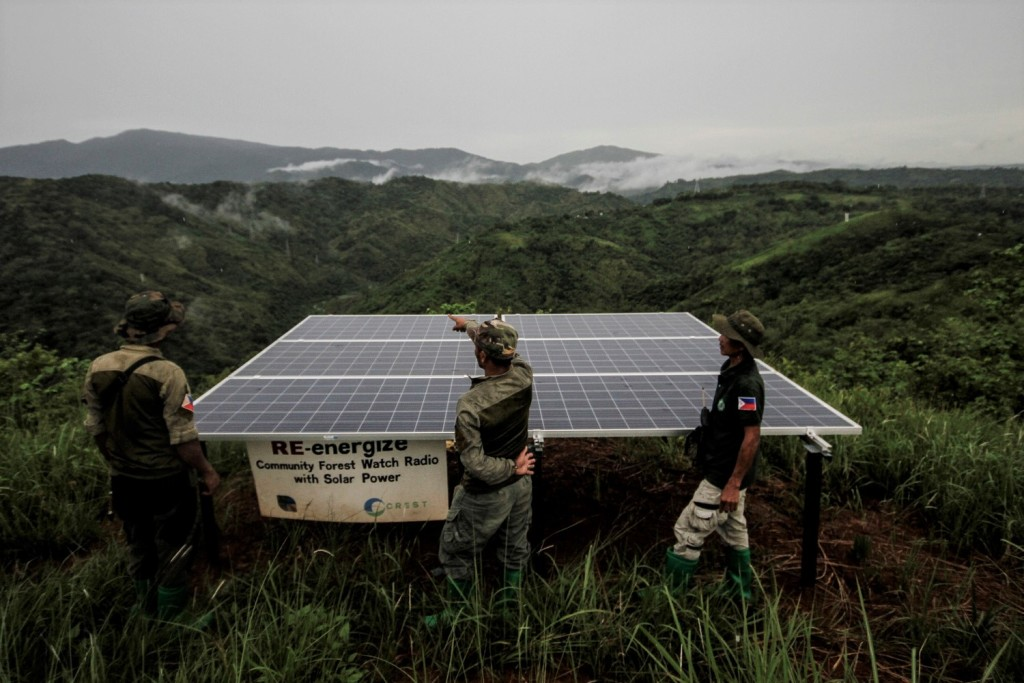 Dumagat forest rangers stand beside a solar micro-grid in Norzagaray, Bulacan, northern Philippines on 26 June 2018. Photo by Alanah Torralba