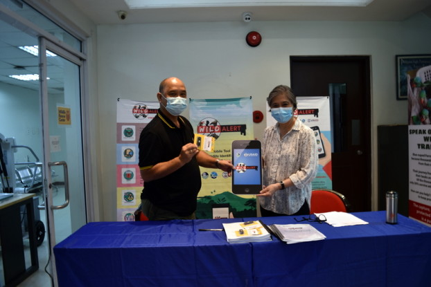 DENR Biodiversity Management Bureau Director Ricardo Calderon receives the complete WildALERT system and manuals from USAID Protect Wildlife Chief of Party Rebecca Paz.
